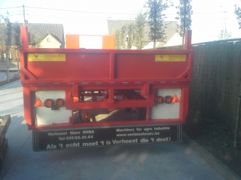 Flat trailer with folding flap